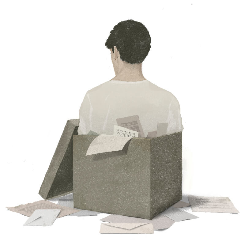 A man trapped at his shoulder in a box full of documents